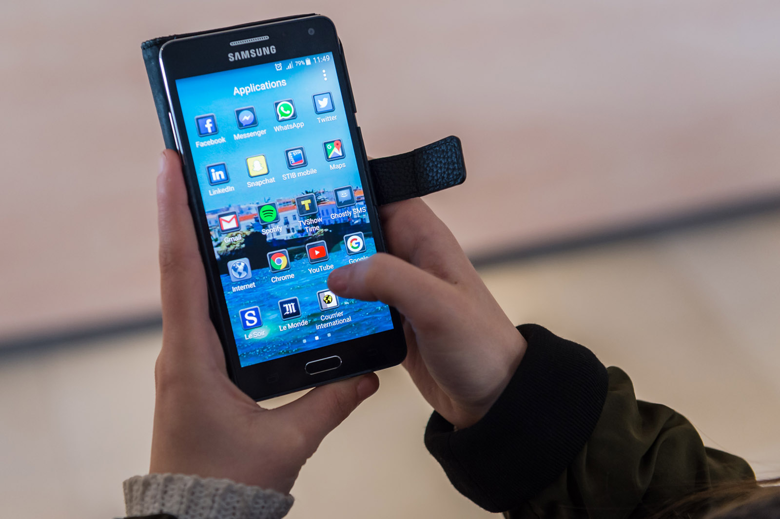 A woman uses an Android smartphone in this April 20, 2016 file photo. Nielsen Holdings reports that FOMO, or the fear of missing out, has become a legitimate phenomenon, especially regarding our smartphones. (AP File Photo/Geert Vanden Wijngaert)