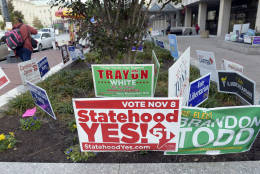 In this photo taken Nov. 3, 2016, signs supporting DC statehood are on display outside an early voting place on in Washington. District of Columbia voters will decide whether they want the nation's capital to become its 51st state. The D.C. Council choices include former Mayor Vincent Gray, and Del. Eleanor Holmes Norton, D-D.C. seeks re-election.  (AP Photo/Susan Walsh)