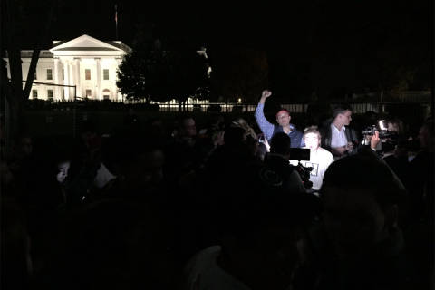 Election uncertain, crowd gathers in front of White House