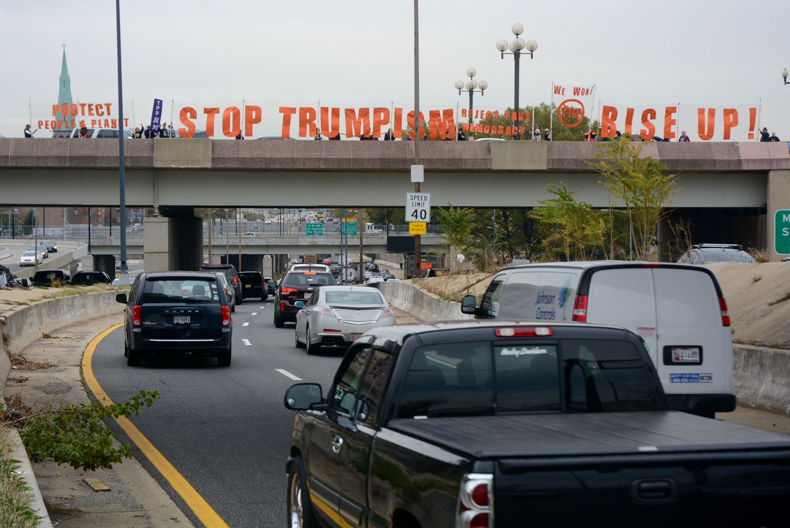 A separate anti-Trump protest in Southwest D.C. on L'Enfant Promenade. Protesters in D.C. briefly blocked lanes on Interstate 395. (WTOP/Dave Dildine)