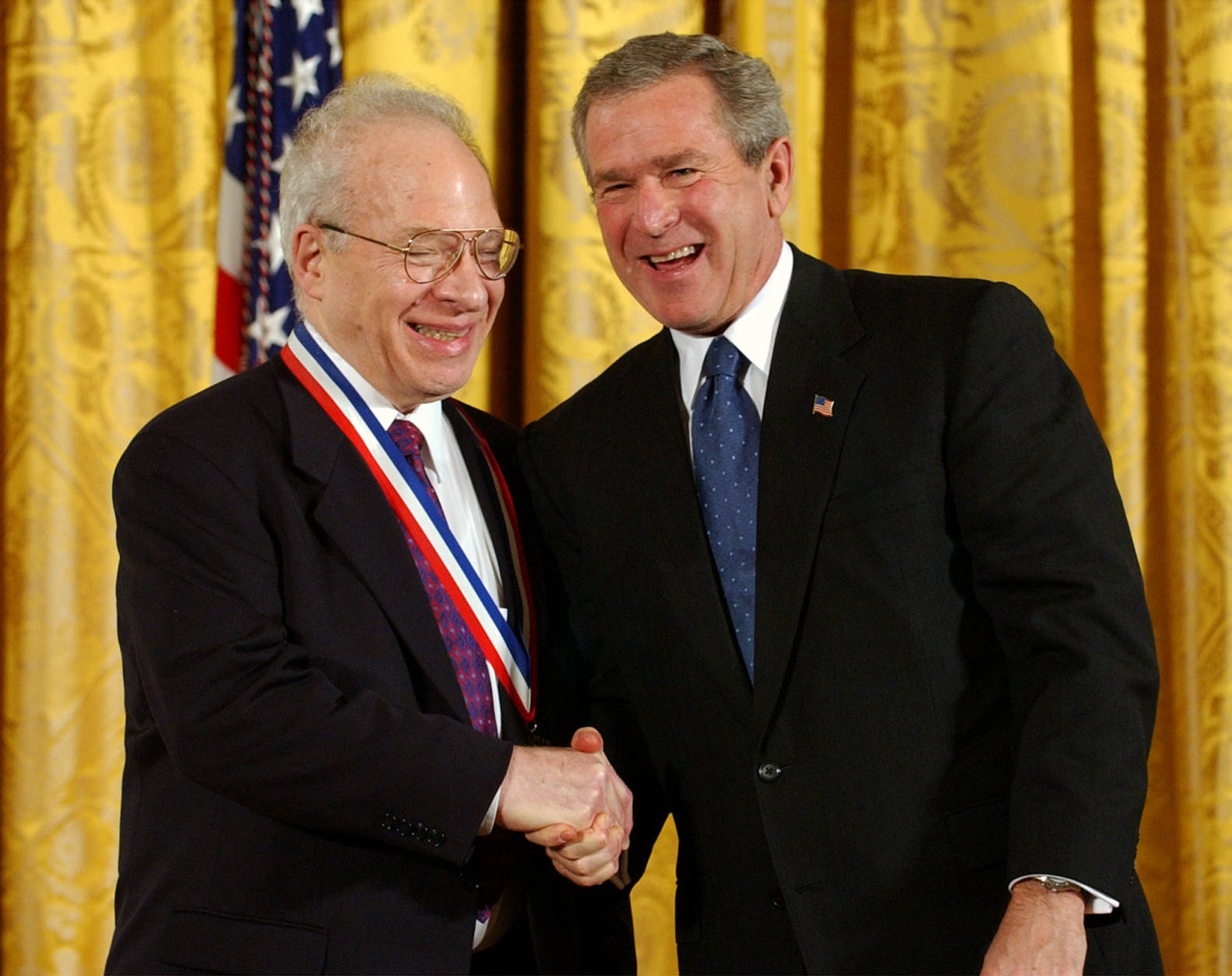 President Bush shakes hands with Richard L. Garwin of the Council on Foreign Relations after presenting him with a National Medal of Science for Physical Sciences in the East Room of the White House in Washington Thursday, Nov. 6, 2003. (AP Photo/Gerald Herbert)