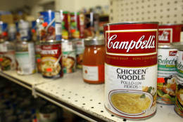 In this photograph taken on Friday, May 22, 2009, dented cans of soup and other canned goods sit on shelves at the Friday Store in Arvada, Colo. Sales at the suburban Denver store have surged in recent months, mirroring the trend at so-called salvage grocers nationwide, as the recession makes frugal living appealing to more Americans. (AP Photo/David Zalubowski)
