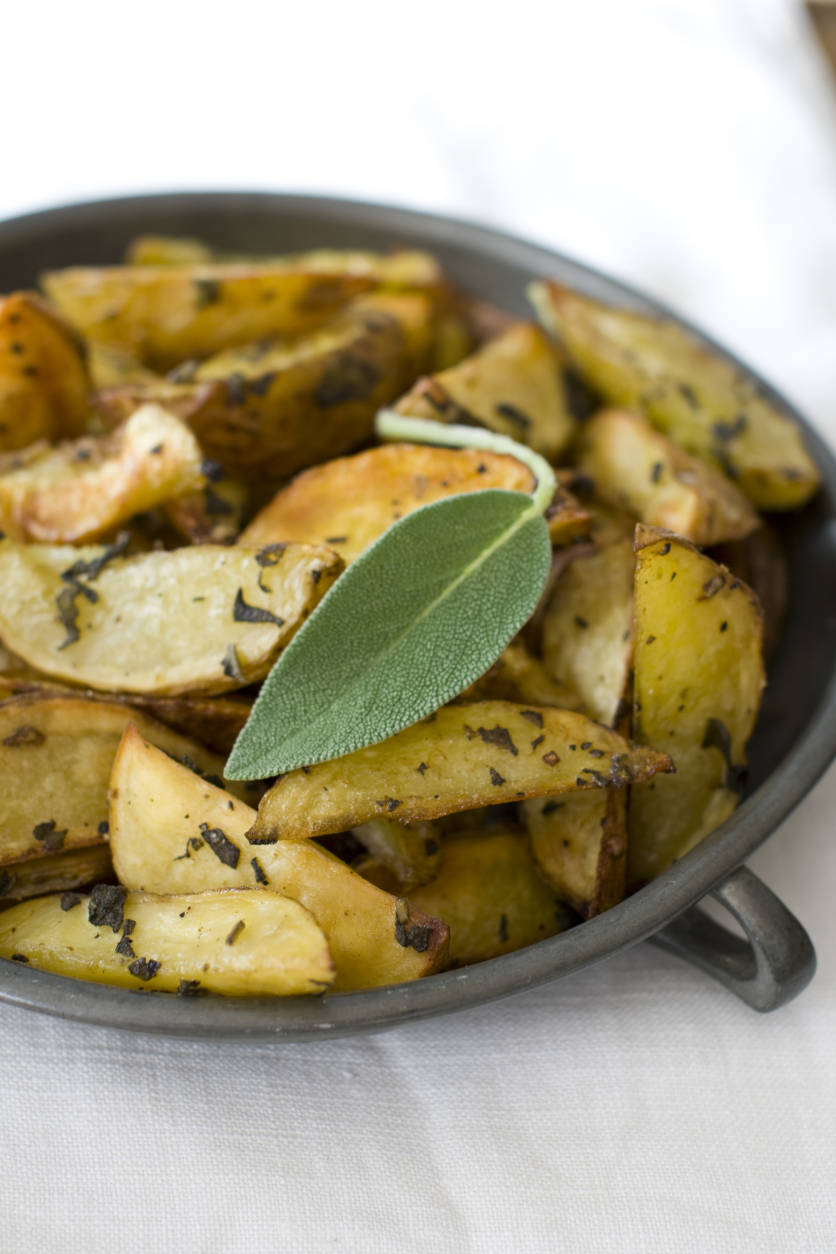 This Oct. 11, 2011 photo shows sage roasted potato wedges in Concord, N.H. Mashed potatoes are traditional, but roasted potatoes can be just as delicious.    (AP Photo/Matthew Mead)