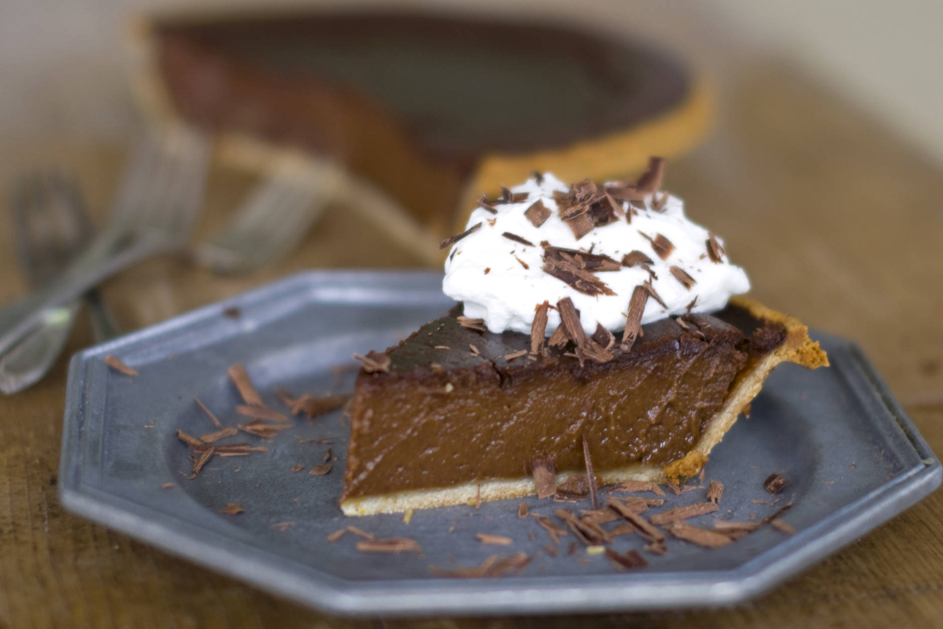 This Oct. 17, 2011 photo shows midnight pumpkin pie in Concord, N.H. This pumpkin pie recipe combines chocolate and pumpkin into a perfectly rich treat that honors tradition while satisfying the need for chocolate.   (AP Photo/Matthew Mead)