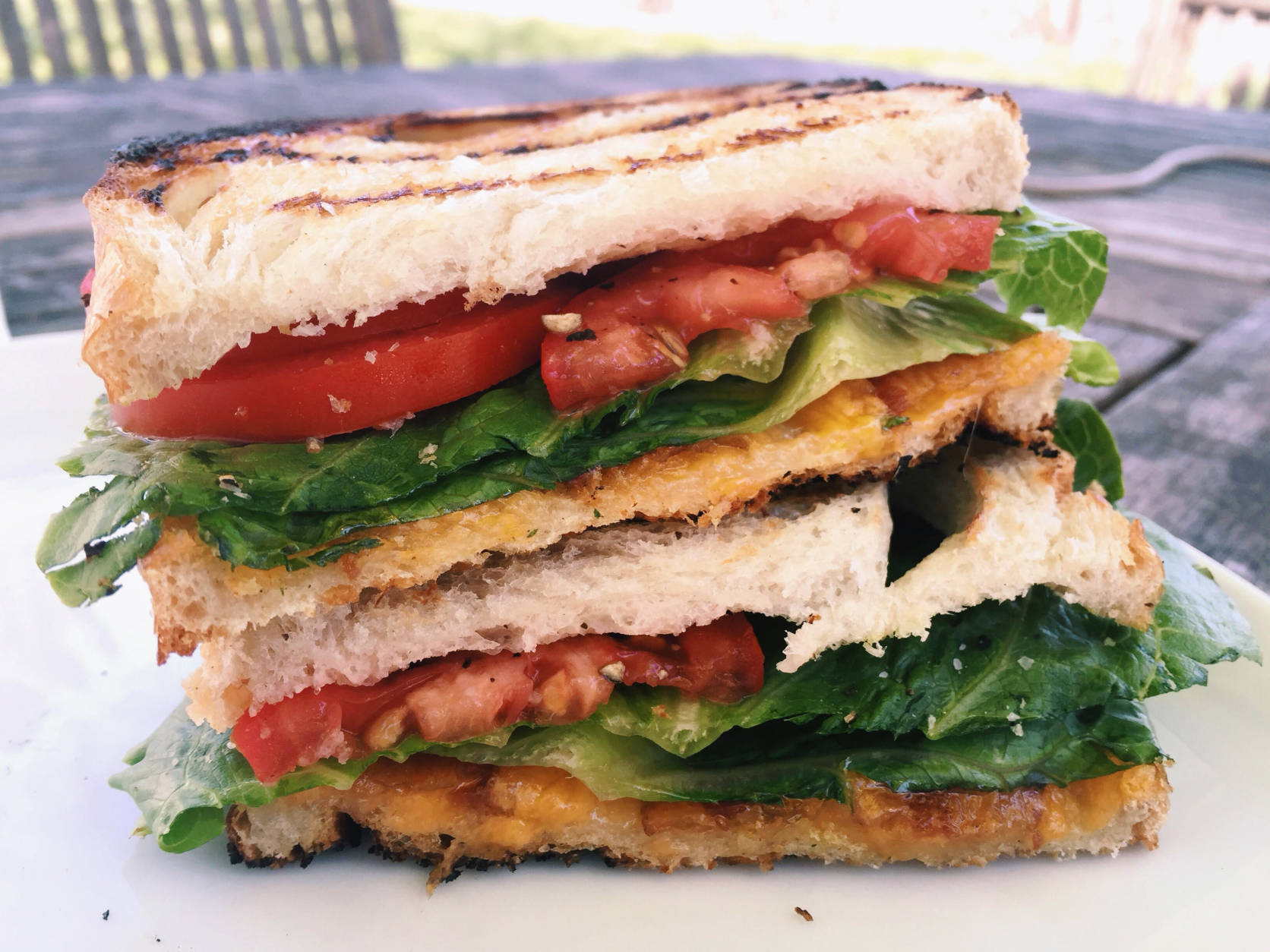This April 17, 2016 photo shows two favorite sandwiches, the BLT and the grilled cheese, coming together as one, in New Milford, Conn.  The buttery crunch of the bread, the juicy tomatoes, the melty cheese, the crisp bacon and lettuce, these two sandwiches were meant to find each other and become one. (AP Photo/Katie Workman)