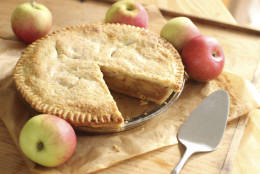 This Sept. 21, 2015 photo shows deep dish apple pie in Concord, NH. Apple pie ingredients are few and elemental: apples, of course, along with sugar, flavoring and pie crust. But choosing the right apples is a serious business. (AP Photo/Matthew Mead)
