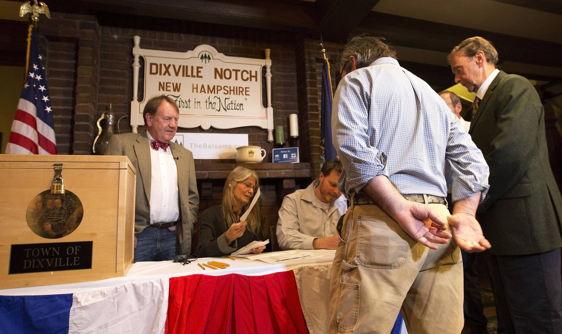 Voters in Dixville Notch, N.H., get their ballots Tuesday, Nov. 8, 2016, in Dixville Notch, N.H. The residents in town voted just after midnight. (AP Photo/Jim Cole)