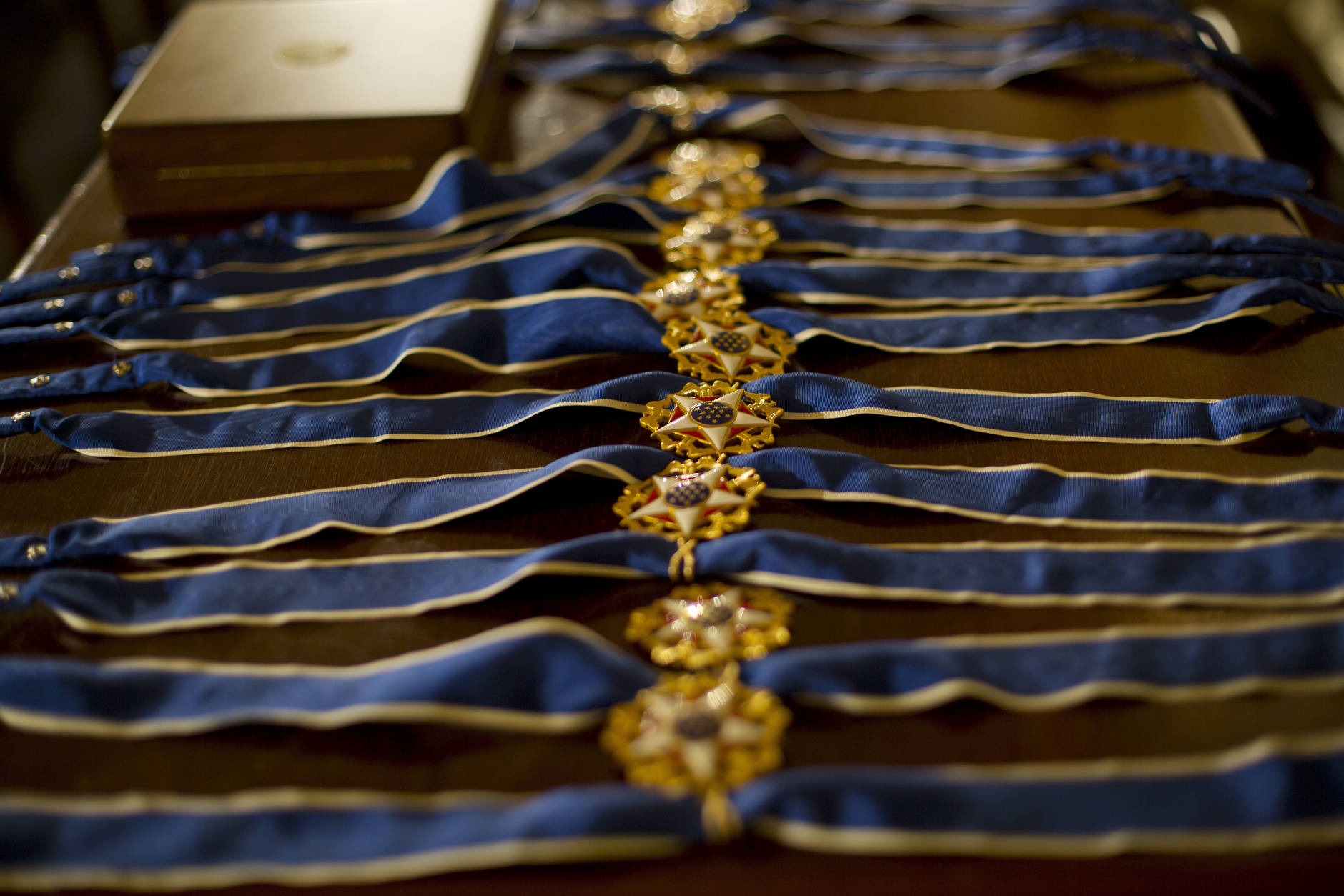 Presidential Medals of Freedom are seen on a table prior to the start of the ceremony in the East Room of the White House Washington, Tuesday, Nov. 22, 2016, where President Barack Obama is recognizing 21 Americans with the nation's highest civilian award, including giants of the entertainment industry, sports legends, activists and innovators. (AP Photo/Pablo Martinez Monsivais)