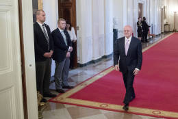 Miami Dade College President Eduardo Padron, right, arrives for a Presidential Medal of Freedom ceremony in the East Room of the White House, Tuesday, Nov. 22, 2016, in Washington. Obama is recognizing 21 Americans with the nation's highest civilian award, including giants of the entertainment industry, sports legends, activists and innovators. (AP Photo/Andrew Harnik)