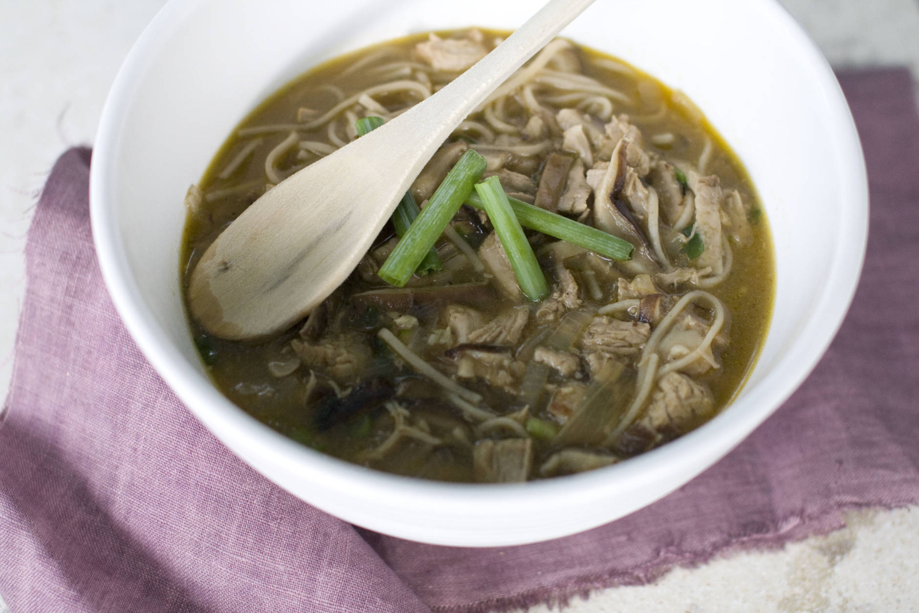 This Aug. 26, 2013 photo shows Shiitake mushroom ginger noodle soup with garlic pork in Concord, N.H. (AP Photo/Matthew Mead)
