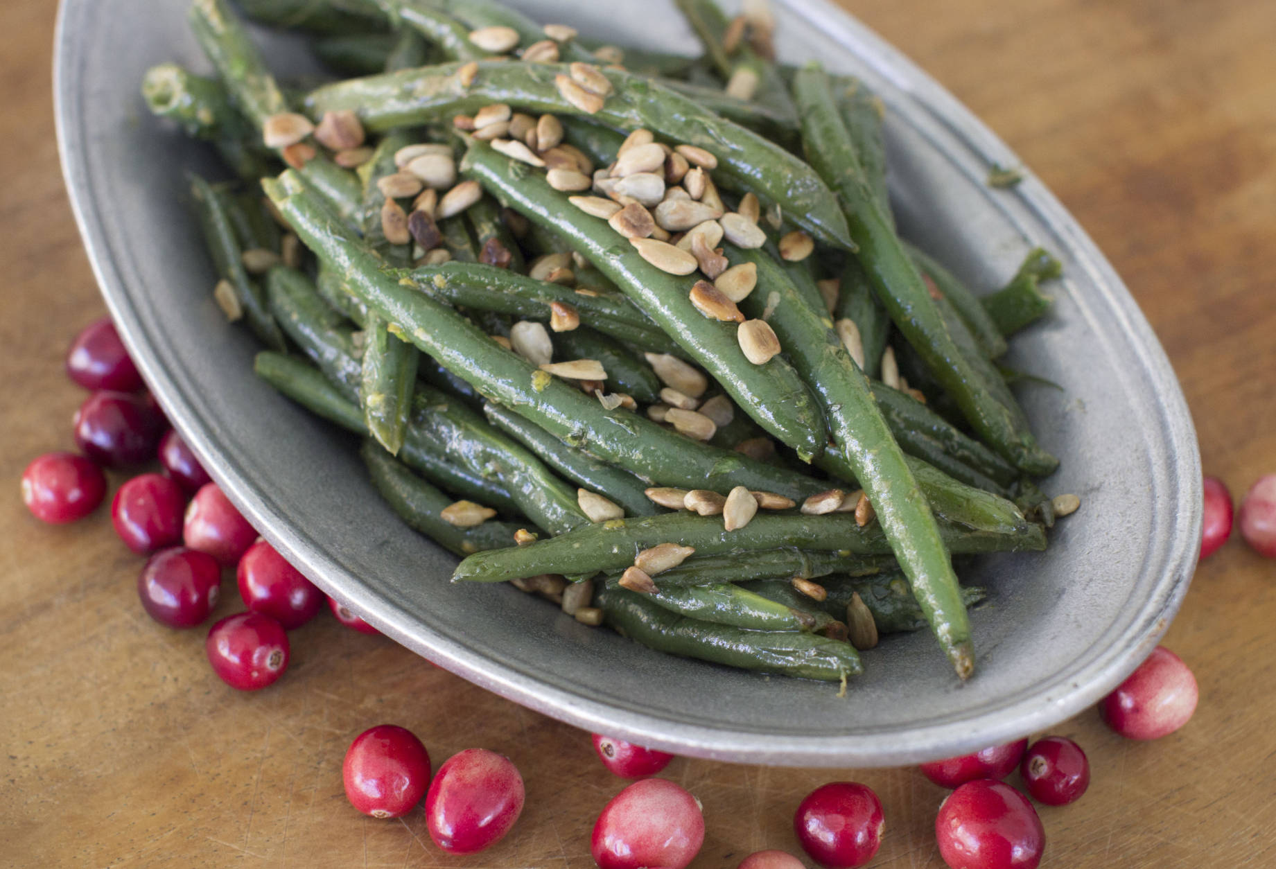 This Oct. 6, 2014 photo shows green beans with tarragon, mustard and sunflower seeds in Concord, N.H. The recipe is simple for skillet green beans bathed in brown butter, then tossed with fresh tarragon, Dijon mustard and lemon zest. (AP Photo/Matthew Mead)