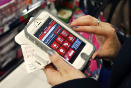 Smartphone apps can help shoppers find coupons, compare prices or price match.  (AP Photo/Michael Dwyer)