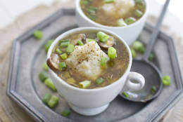 In this image taken on Sept. 17, 2012, cups of Mushroom and Chicken Barley Soup with Parmesan Dumplings are shown in Concord, N.H. (AP Photo/Matthew Mead)