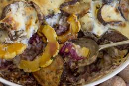This Oct. 27, 2014 photo shows Thanksgiving eggplant strata in Concord, N.H. The deliciously creamy strata marries layers of roasted eggplant, delicata squash and red cabbage with a rich bechamel sauce. (AP Photo/Matthew Mead)