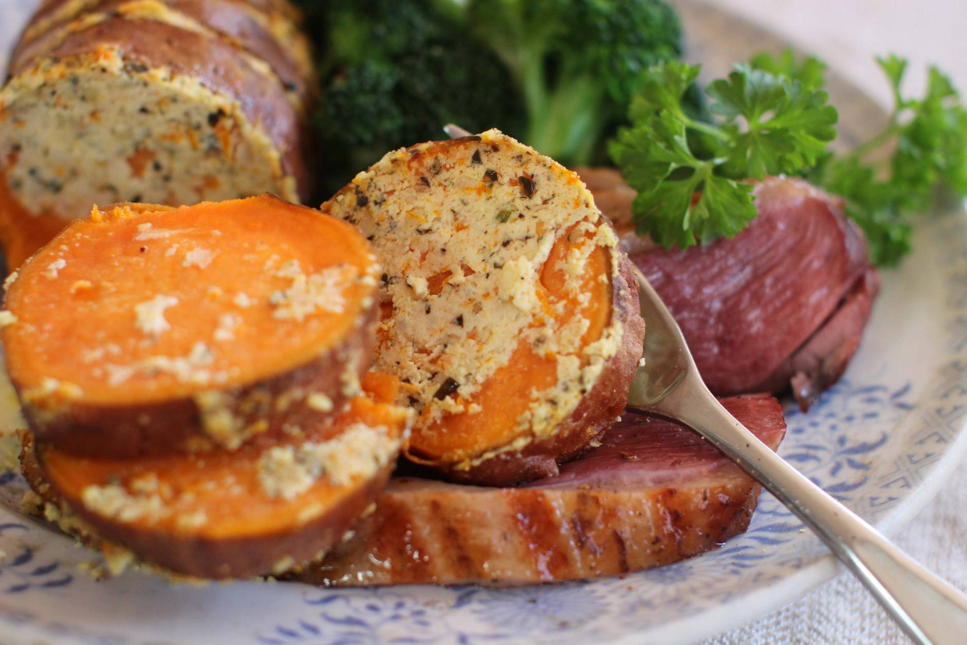 This April 13, 2015 photo shows goat cheese stuffed grilled sweet potatoes in Concord, N.H. (AP Photo/Matthew Mead)