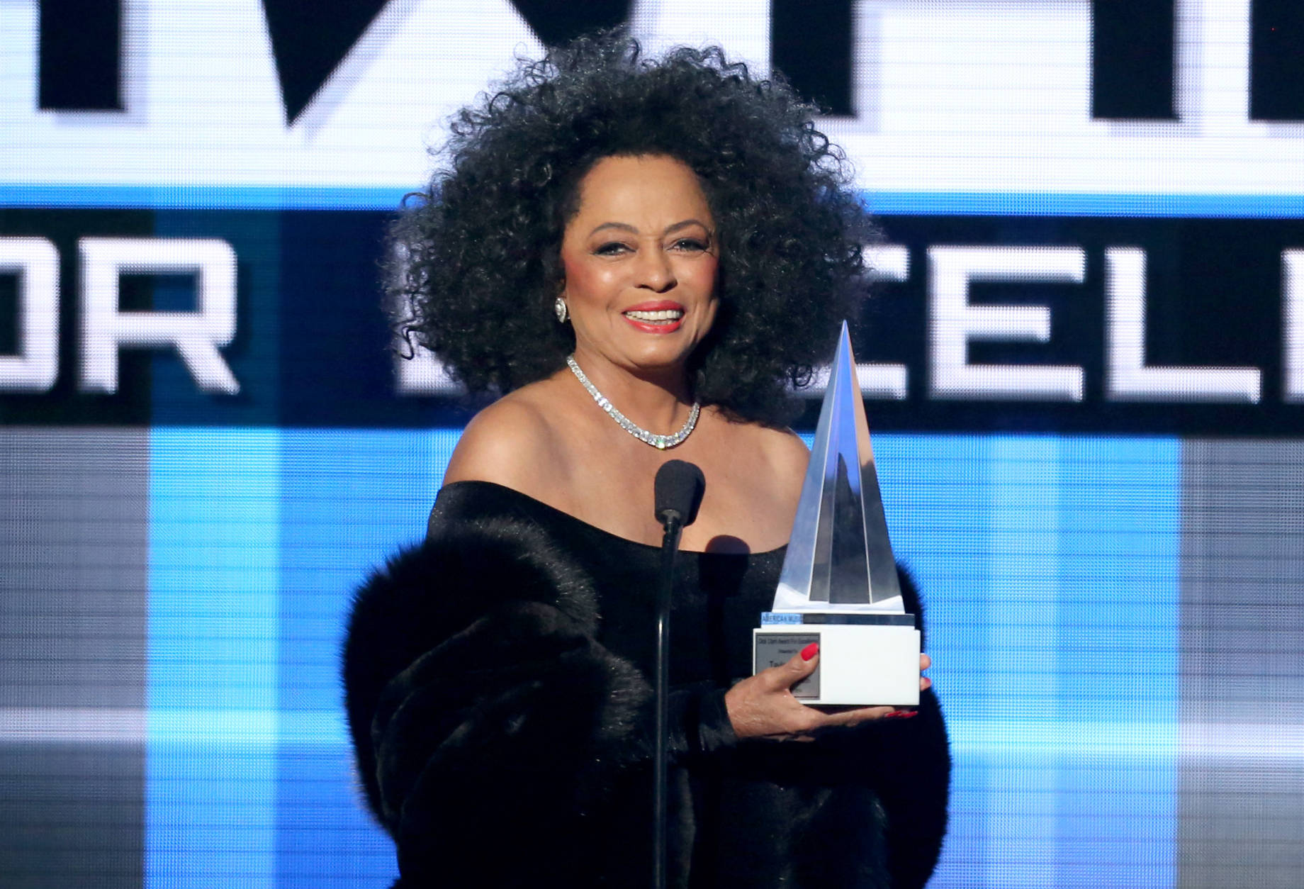 Diana Ross presents the Dick Clark award for excellence at the 42nd annual American Music Awards at Nokia Theatre L.A. Live on Sunday, Nov. 23, 2014, in Los Angeles. (Photo by Matt Sayles/Invision/AP)