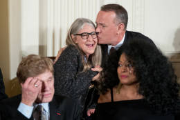 Mathematician and computer scientist Margaret Hamilton gets a kiss from actor Tom Hanks, right, after she receives the Presidential Medal of Freedom from President Barack Obama during a ceremony in the East Room of the White House, Tuesday, Nov. 22, 2016, in Washington. Obama is recognizing 21 Americans with the nation's highest civilian award, including giants of the entertainment industry, sports legends, activists and innovators. (AP Photo/Andrew Harnik)