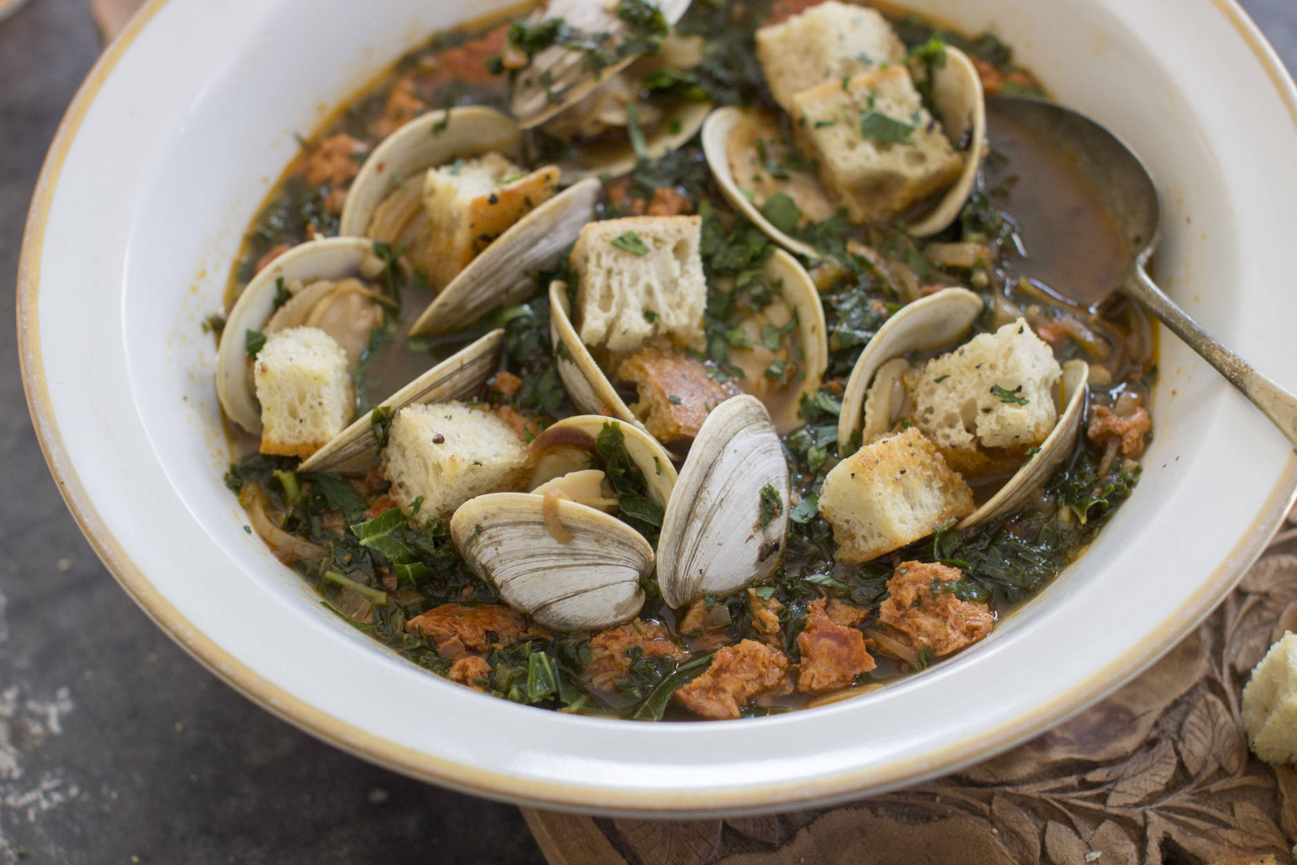 "This Jan. 5, 2015 photo shows spicy clam and kale soup in Concord, N.H. Tucked away between the tofu ""cheeses"" and textured vegetable protein taco crumbles lies a good go-to and good-for-you ingredient, soy chorizo.  (AP Photo/Matthew Mead)"
