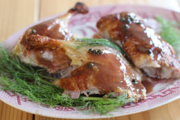 This Oct. 26, 2015, photo, shows bistro style slow roasted duck in Concord, N.H. Roasting a duck is no more complicated than roasting a turkey, and this recipe also has a French-style sauce. (AP Photo/Matthew Mead)