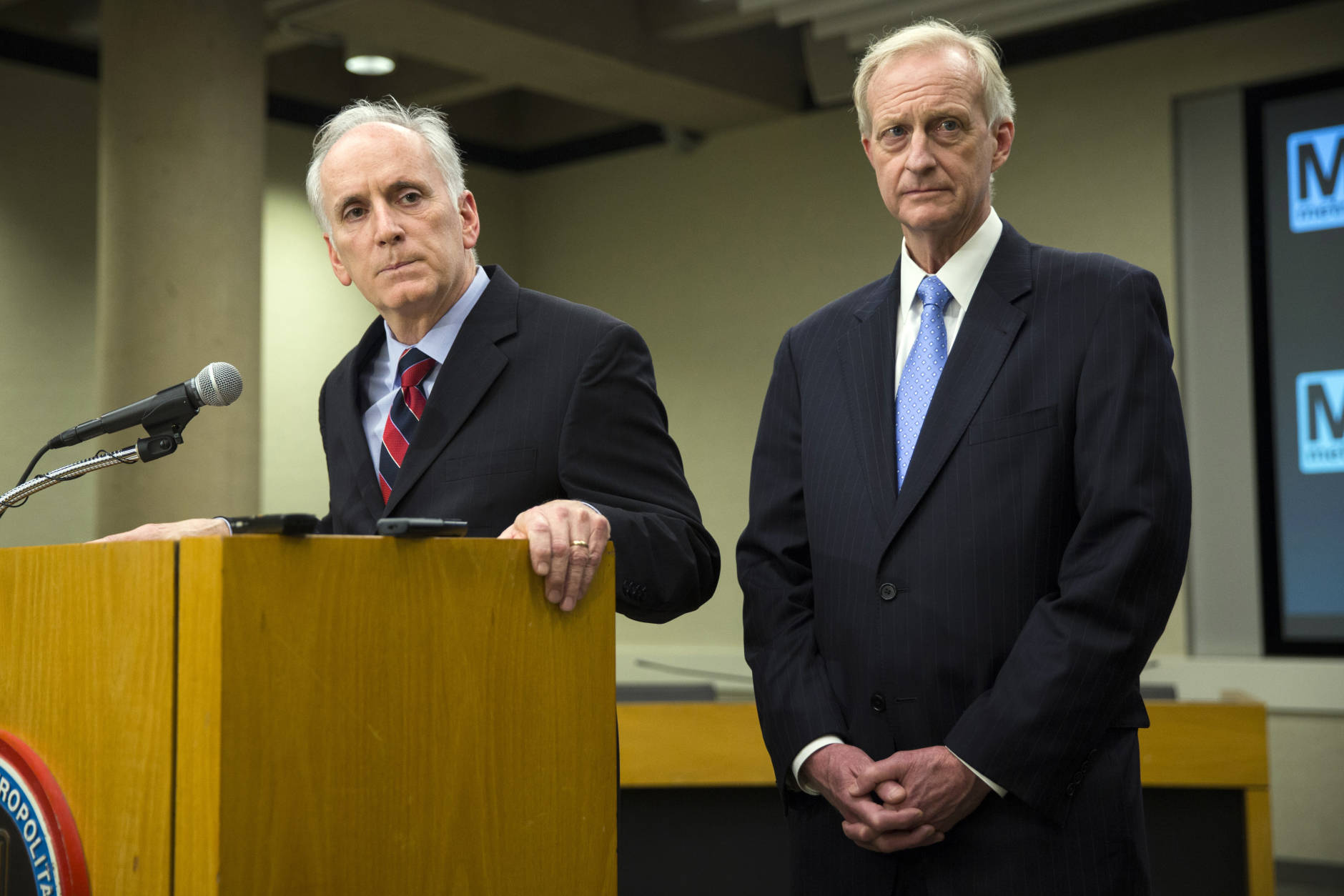DC Council Member Jack Evans, right, and Metro General Manager Paul Wiedefeld listen to a question during a news conference to announce that the DC Metrorail service will be shut down for a fulls day, at the Washington Metropolitan Area Transit Authority headquarters, on Tuesday, March 15, 2016, in Washington. Wiedefeld said the system would be shut down for an emergency inspection of the system's third rail power cables. (AP Photo/Evan Vucci)