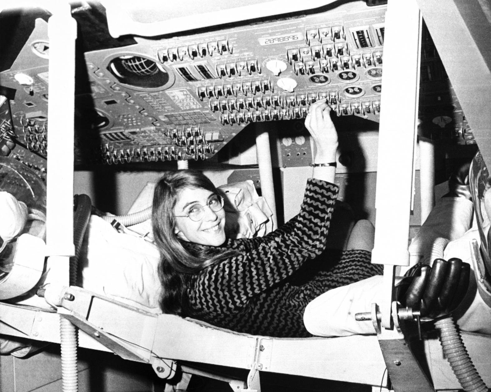 Margaret Hamilton of Cambridge, Mass., mathematic and computer programmer at the MIT Instrumentation Laboratory, sits in mock up of Apollo command module on display at the Cambridge school, Nov. 25, 1969 where she headed group that programmed Intrepid's pinpoint landing in the Sea of Storms on the moon. (AP Photo)