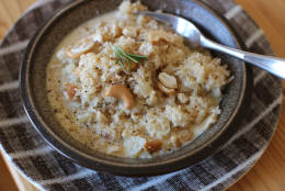 This Nov. 16, 2015 photo shows parmesan cashew cauliflower risotto in Concord, N.H. Transforming finely chopped cauliflower is so popular, grocers now sell bagged minced cauliflower labeled as ready to use in your favorite pizza crust and mashed potato-like recipes. (AP Photo/Matthew Mead)