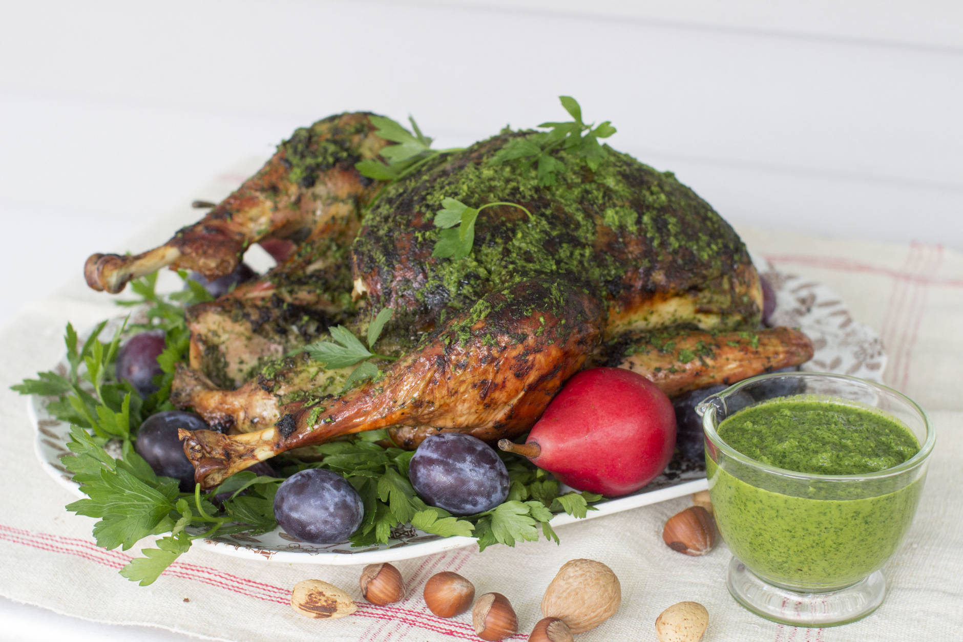 This Sept. 29, 2014, photo shows herb roasted Thanksgiving turkey in Concord, N.H. The inspiration for the turkey came from South American chimichurri, a richly herby sauce that pairs beautifully with roasted meats. (AP Photo/Matthew Mead)