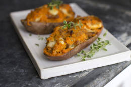 This July 28, 2014, photo shows apple-sausage stuffed twice-baked sweet potatoes in Concord, N.H. Add a bit of cheese to tie it all together and the meal takes just 20 minutes hands-on time. (AP Photo/Matthew Mead)