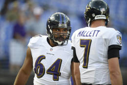Baltimore Ravens center John Urschel (64) stands next to quarterback Ryan Mallett (7) before an NFL preseason football game against the Carolina Panthers, Thursday, Aug. 11, 2016, in Baltimore. (AP Photo/Nick Wass)