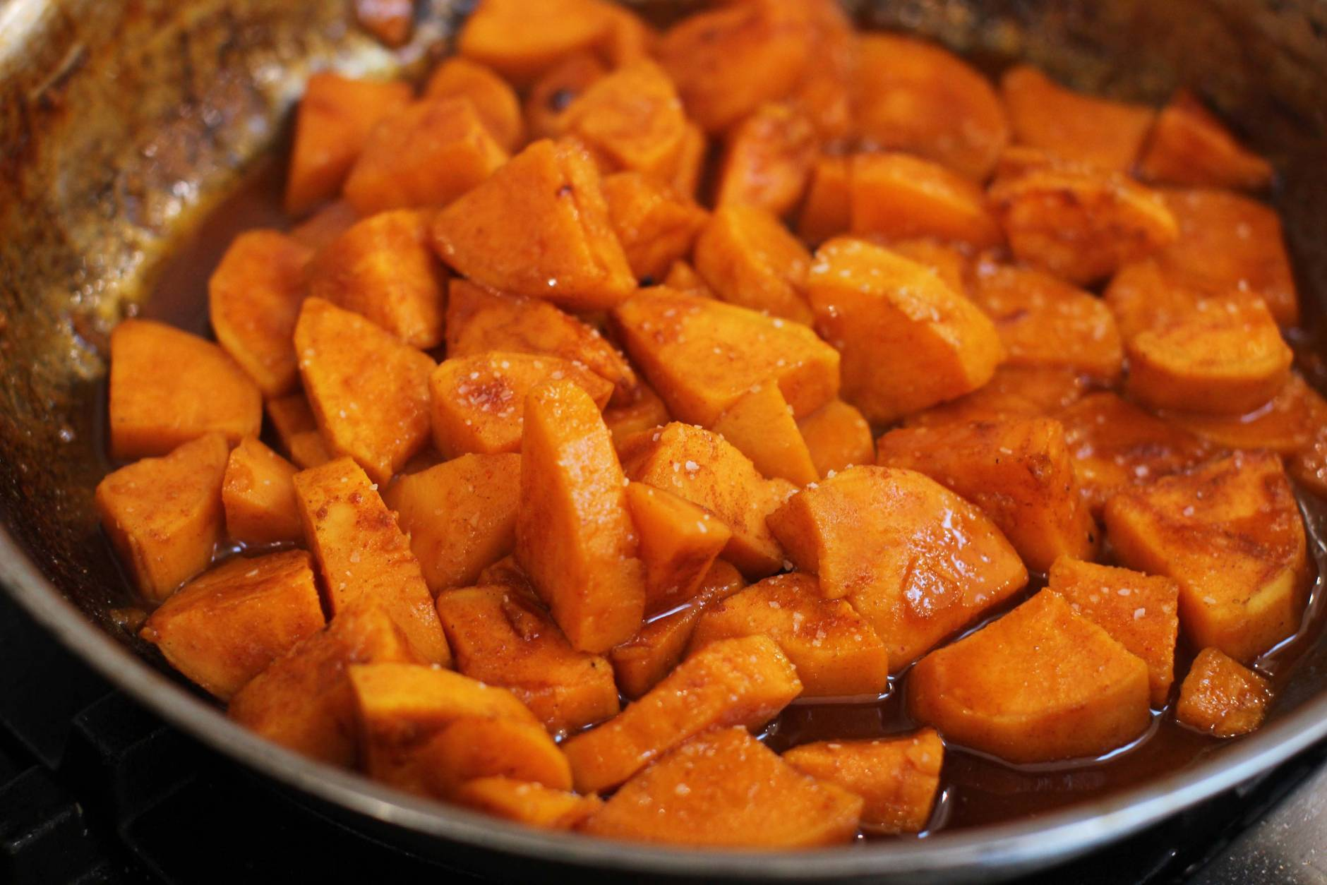 This Oct.  26, 2015 photo shows skillet glazed spicy sweet potatoes in Concord, NH.  No room in the oven, you can cook these delicious glazed sweet potatoes on top of the stove in about 10 minutes flat. (AP Photo/Matthew Mead)