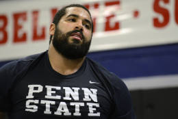 In this Tuesday, March 8, 2014 photo, Penn State lineman John Urschel takes a brief rest during a mixed martial arts workout in State College, Pa.  If it wasn't for my MMA workouts in the afternoons, I don't know how I would get all my aggression out. Football has many virtues, but for myself, I would say this is the greatest. It is a platform for me to get out all aggressive and physical behavior that is not socially acceptable outside of the gridiron. (AP Photo/Ralph Wilson)