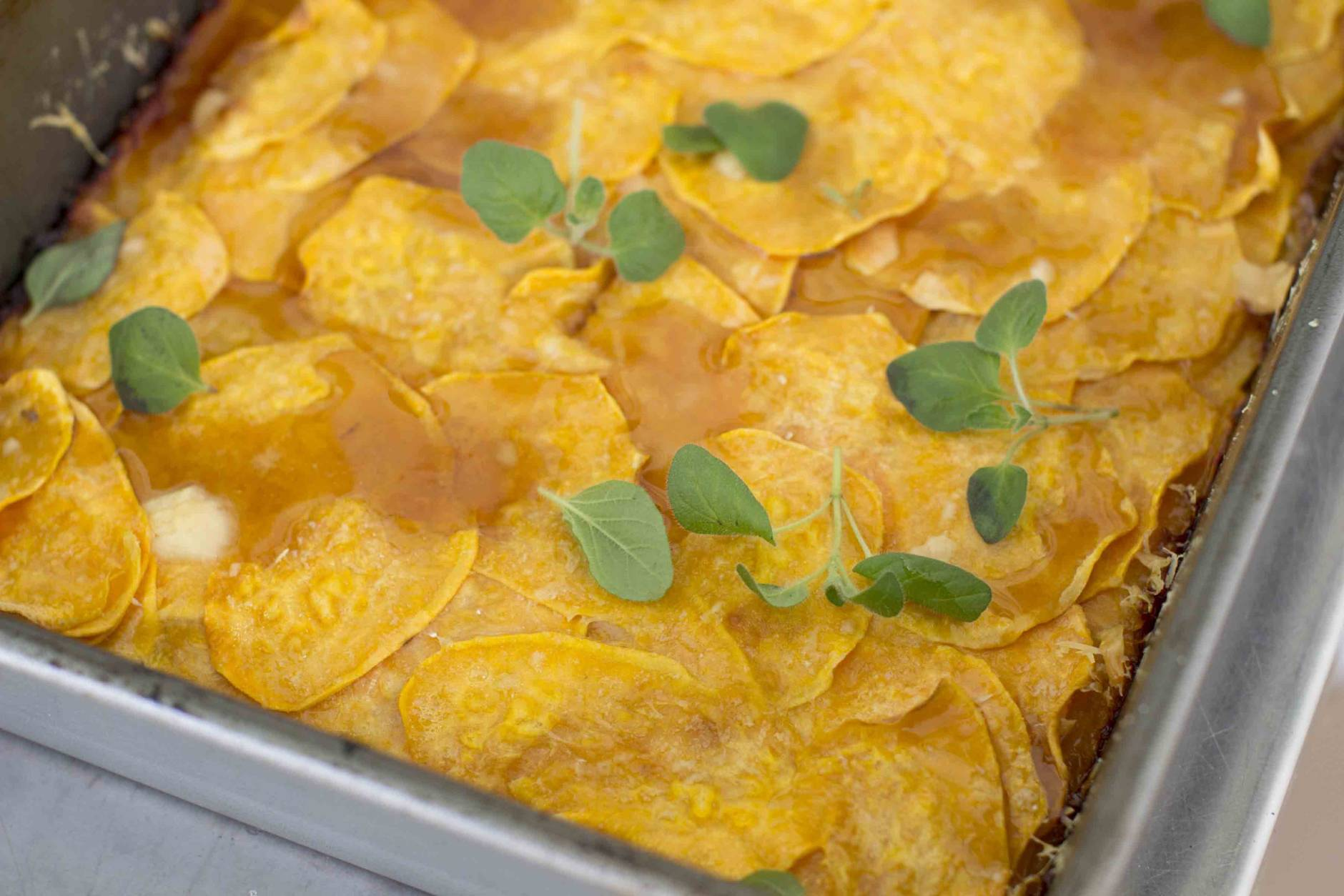 This Oct. 20, 2014, photo shows sweet potato tart with Parmesan and maple syrup in Concord, N.H. No matter how classic or traditional they may be, sweet potatoes can be a bit of a challenge to serve at Thanksgiving. (AP Photo/Matthew Mead)