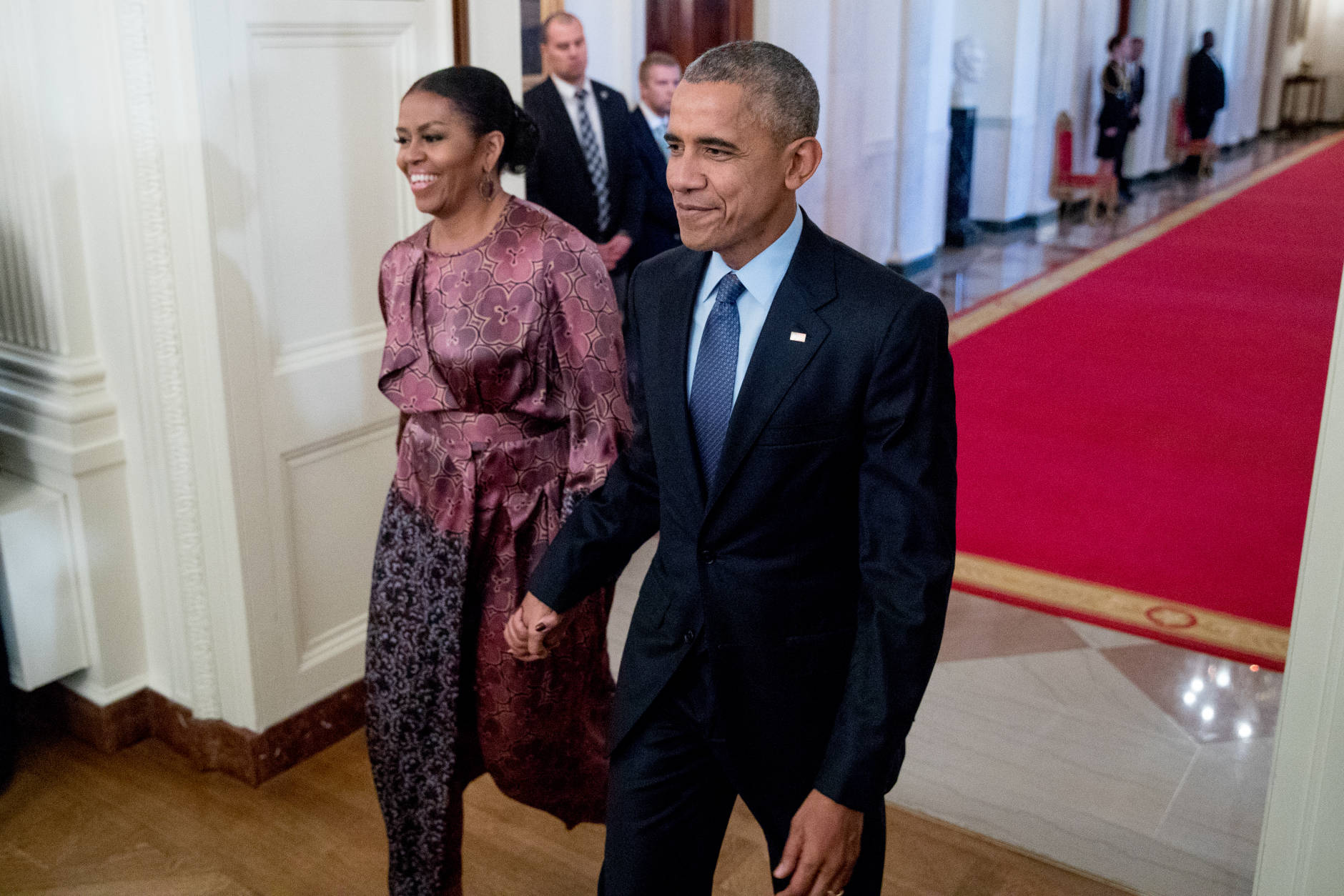 President Barack Obama and first lady Michelle Obama, left, arrive for a Presidential Medal of Freedom ceremony in the East Room of the White House, Tuesday, Nov. 22, 2016, in Washington. Obama is recognizing 21 Americans with the nation's highest civilian award, including giants of the entertainment industry, sports legends, activists and innovators. (AP Photo/Andrew Harnik)
