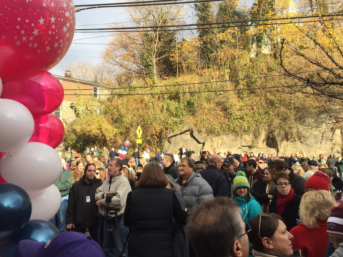 """Crowds gather on Main Street in Ellicott City for Small Business Saturday on Saturday, Nov. 26, 2016, which was marked by a ribbon cutting ceremony officially """"reopening"""" Main Street after July's deadly flood. (WTOP/John Domen)"""