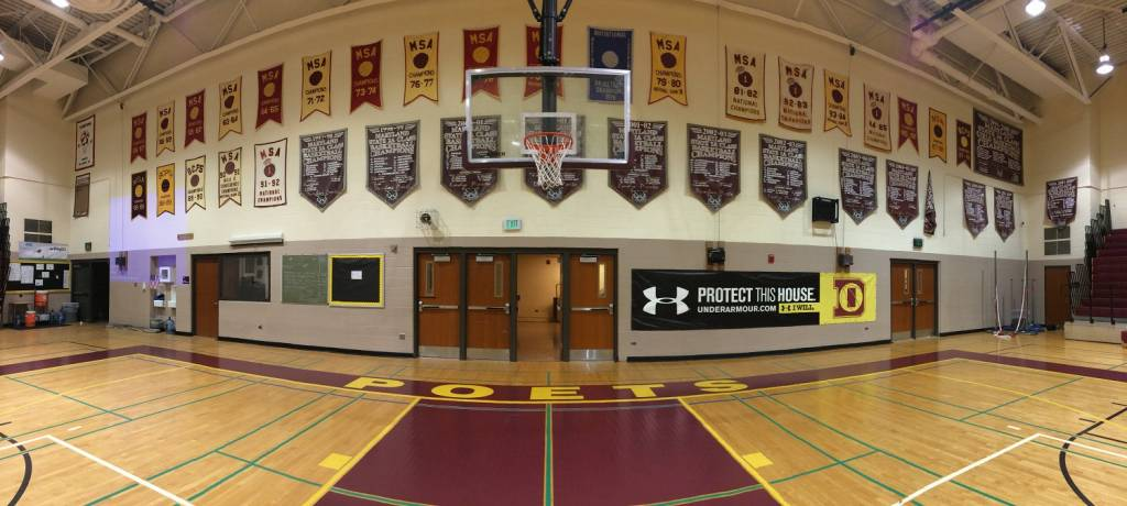 Banners hang on the wall at Dunbar High School's gym. (WTOP/Noah Frank)