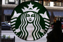 FILE - This Saturday, May 31, 2014, file photo, shows the Starbucks logo at one of the company's coffee shops in downtown Chicago. Starbucks reports financial results Thursday, Nov. 3, 2016. (AP Photo/Gene J. Puskar, File)