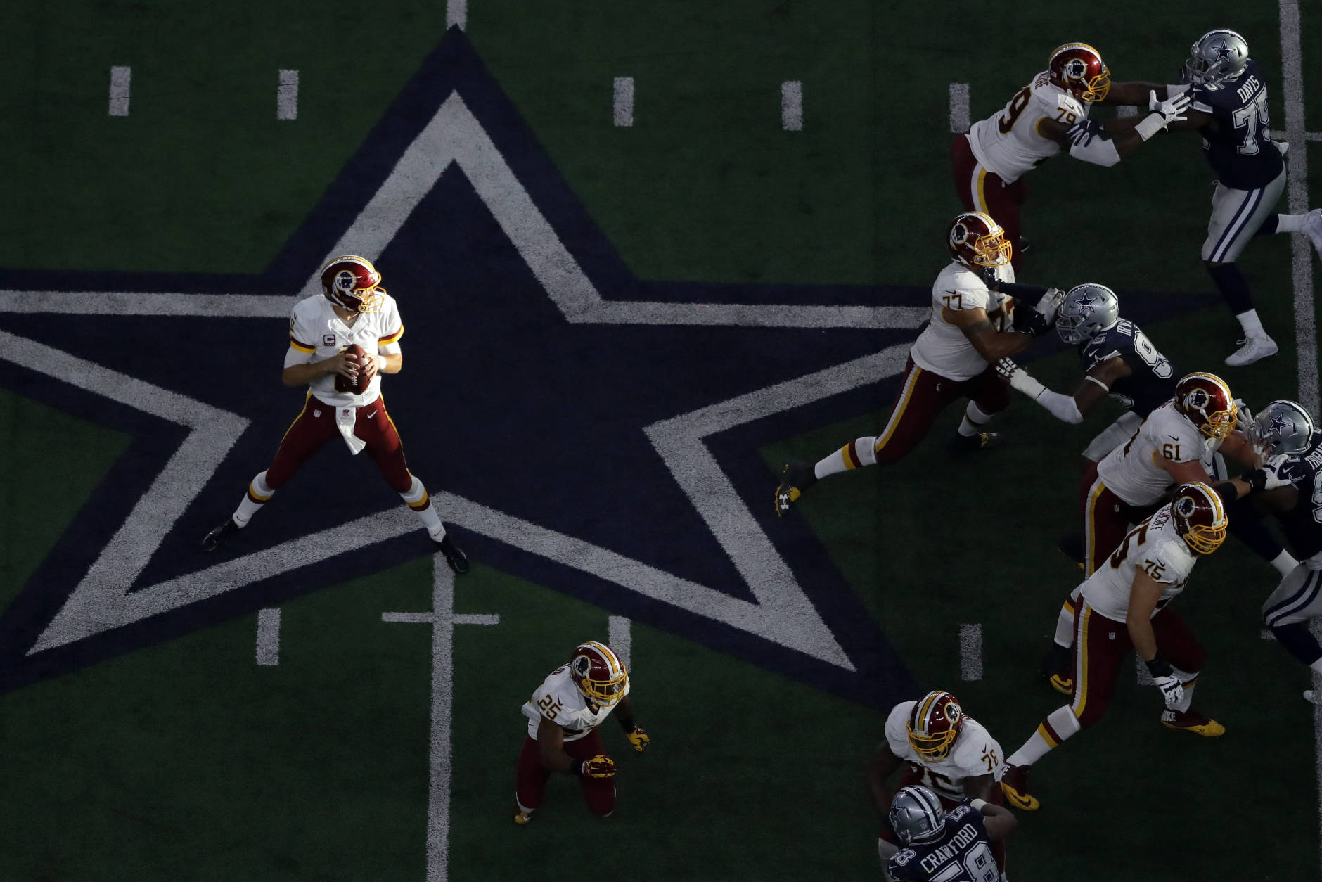 ARLINGTON, TX - NOVEMBER 24:   Kirk Cousins #8 of the Washington Redskins drops back to pass during the first half against the Dallas Cowboys at AT&T Stadium on November 24, 2016 in Arlington, Texas.  (Photo by Ronald Martinez/Getty Images)