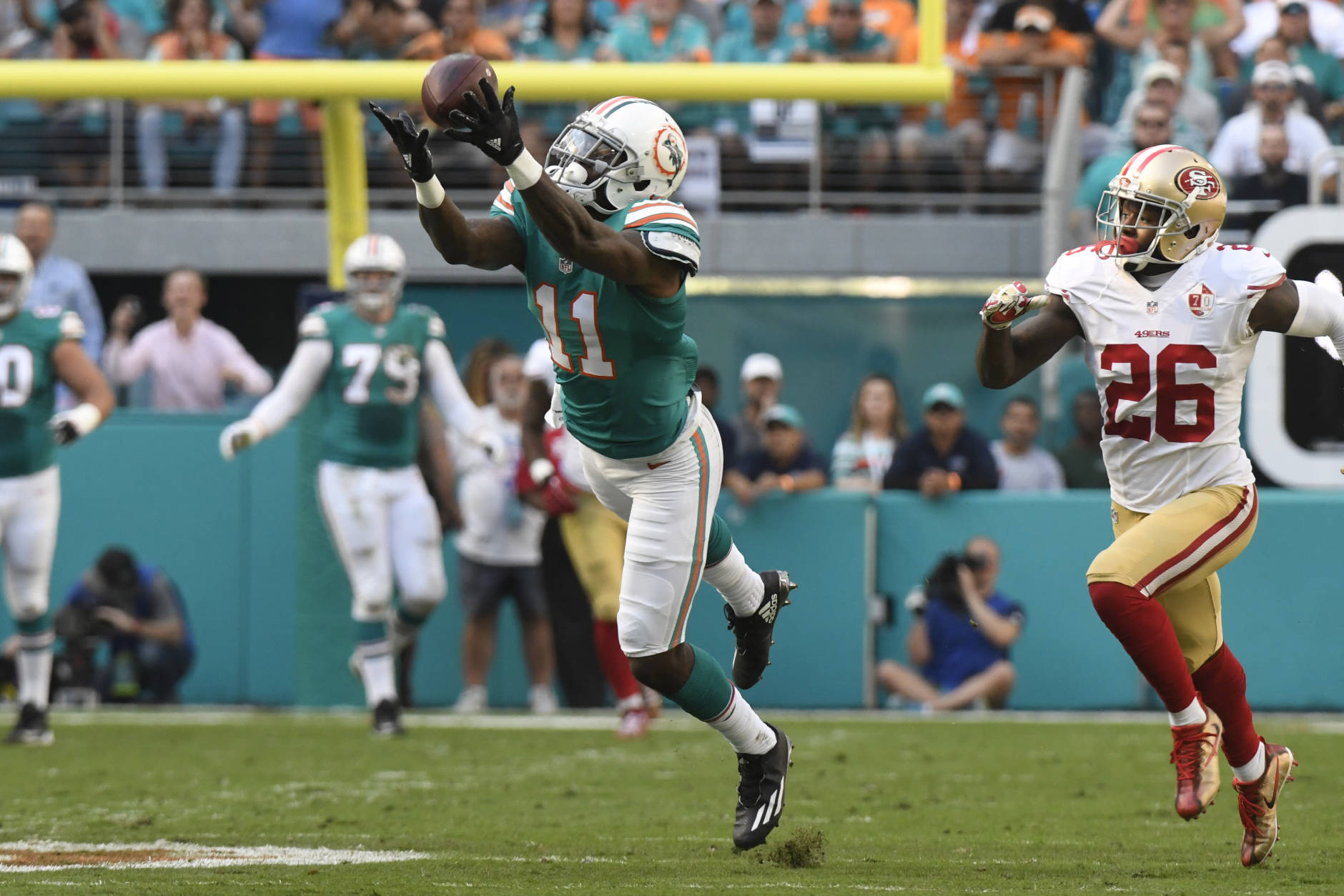 MIAMI GARDENS, FL - NOVEMBER 27: DeVante Parker #11 of the Miami Dolphins makes a 46 yard catch in the 1st quarter against the San Francisco 49ers  at Hard Rock Stadium on November 27, 2016 in Miami Gardens, Florida. (Photo by Eric Espada/Getty Images)