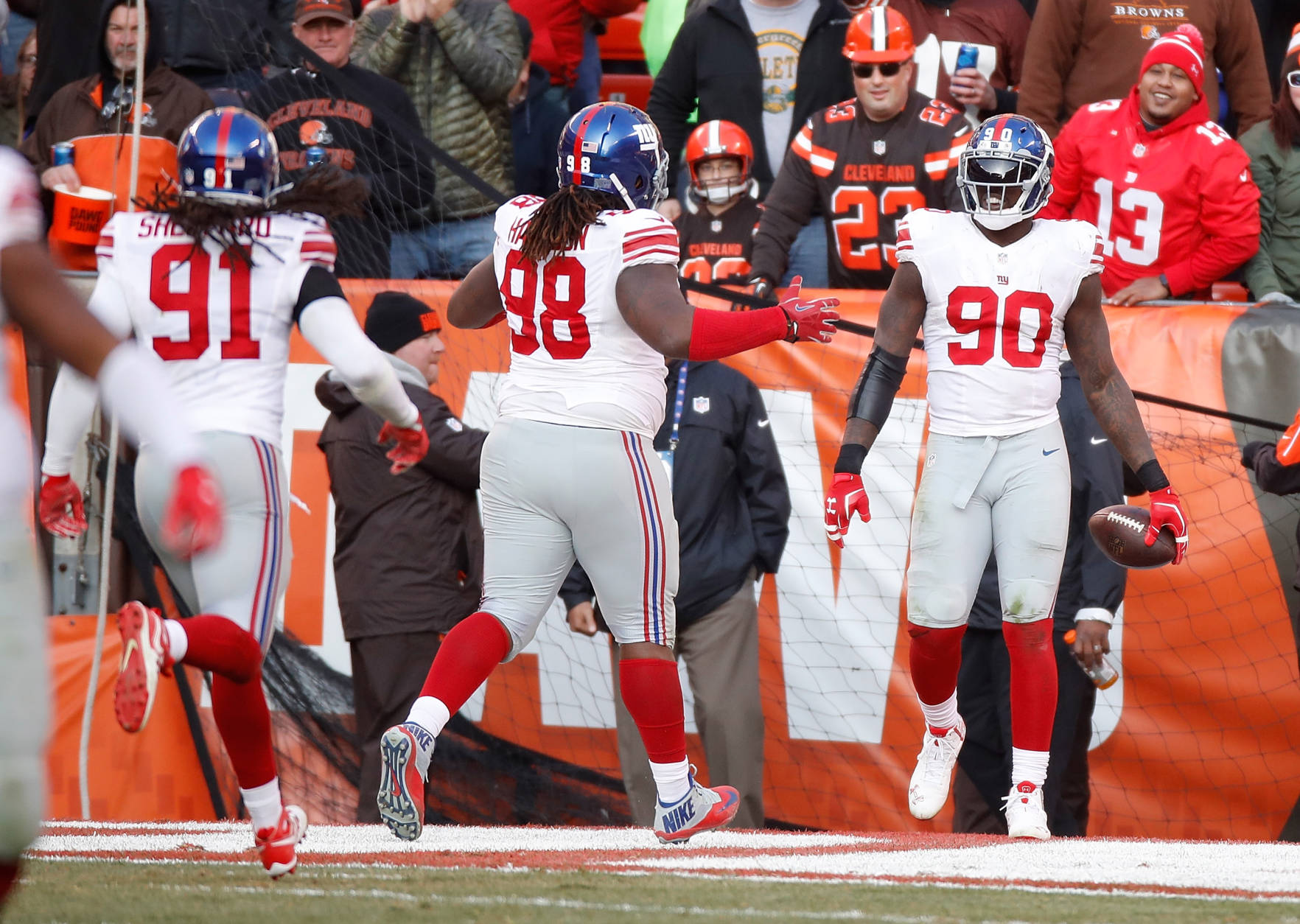 CLEVELAND, OH - NOVEMBER 27:  Jason Pierre-Paul #90 of the New York Giants celebrates his interception return for a touchdown with teammates during the fourth quarter against the Cleveland Browns at FirstEnergy Stadium on November 27, 2016 in Cleveland, Ohio. (Photo by Gregory Shamus/Getty Images)