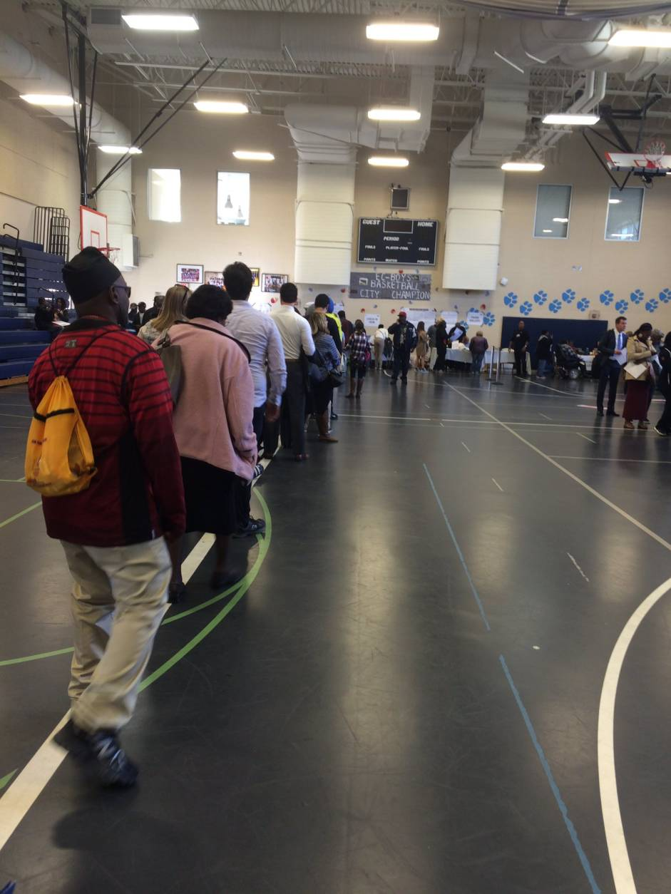 Voters in the Mount Vernon Triangle neighborhood of Northwest D.C. experience a wait time of about 45 minutes as of 11:10 a.m. (WTOP/Sarah Beth Hensley)