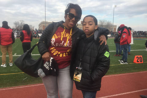 Boy who survived bullet to head cheers on at DC Turkey Bowl