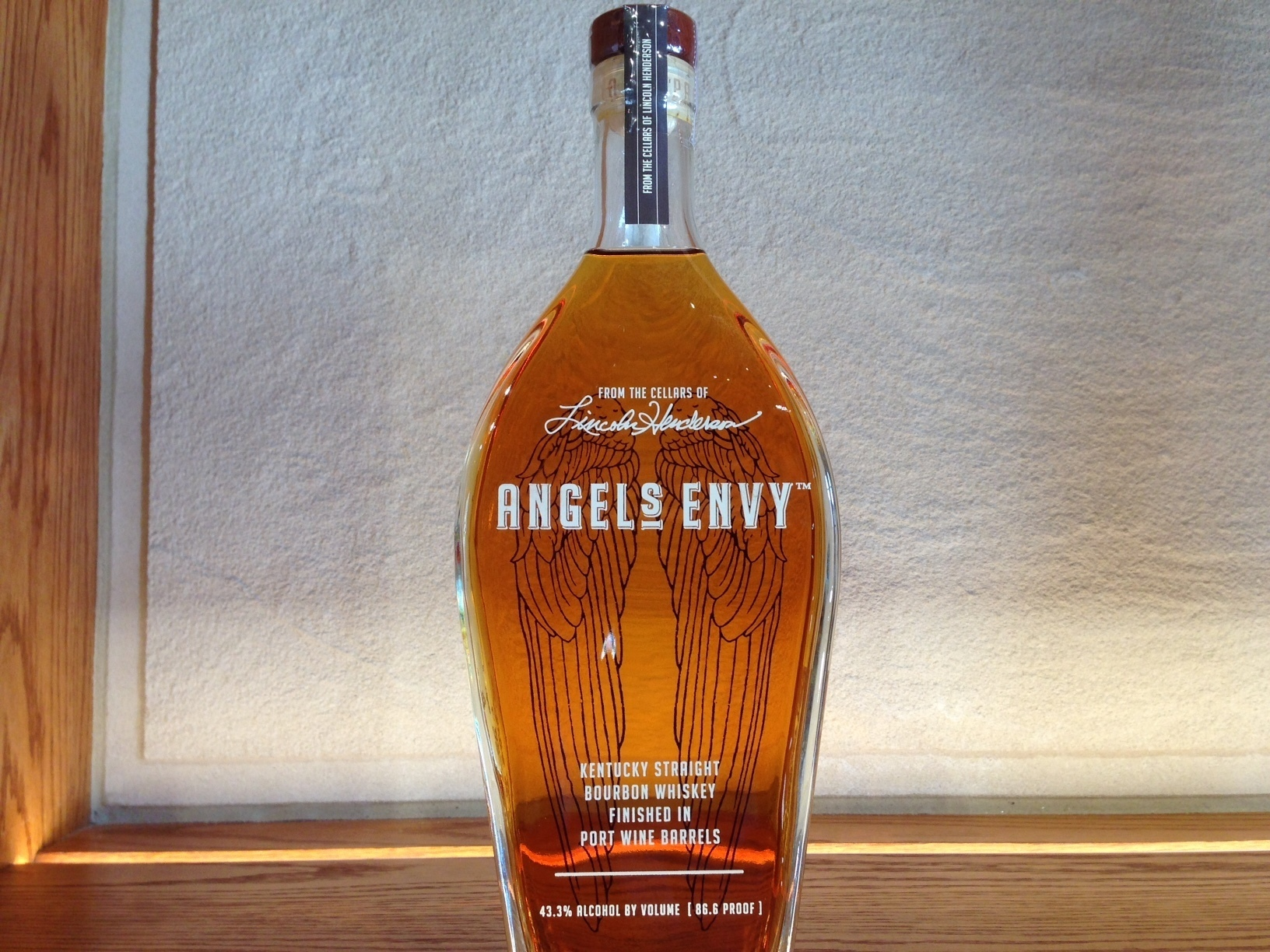 A bottle of Angel's Envy bourbon is displayed at the gift shop of Angel's Envy distillery, in Louisville, Ky. Visitors to Louisville's newest distillery raised glasses Wednesday to toast the opening of the Angel's Envy facility in a high-profile location downtown. Tourism officials are celebrating another sign of bourbon's momentum in a city riding a wave of whiskey-inspired tourism. (AP Photo/Bruce Schreiner)