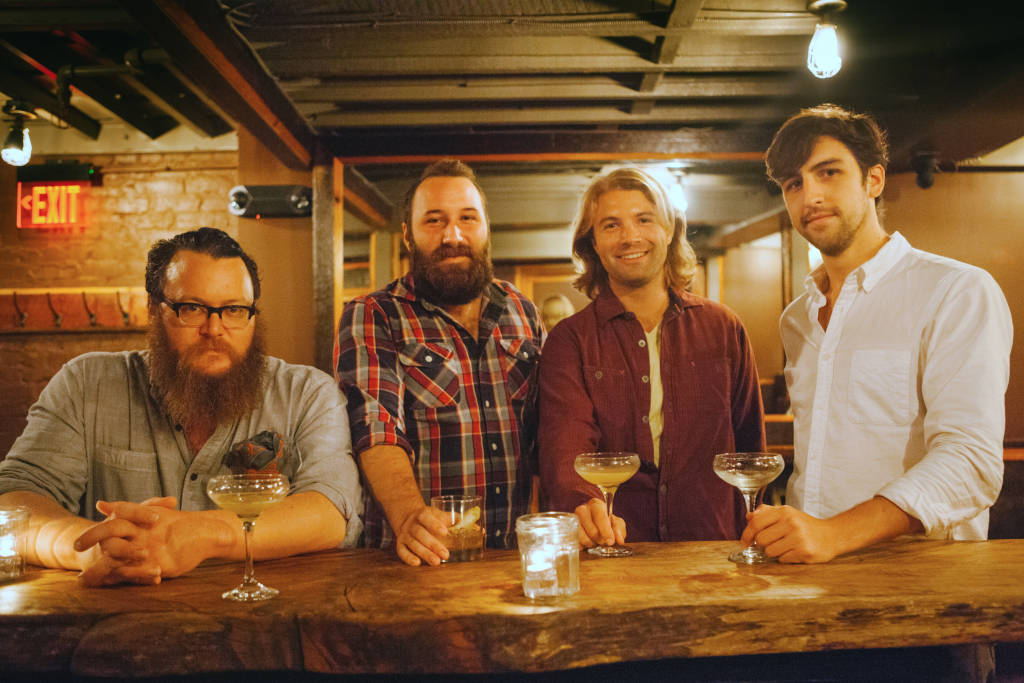 Bar manager Lukas Smith and distiller Chas Jefferson with Cotton & Reed co-founders Reed Walker and Jordan Cotton. (Courtesy Cotton & Reed)