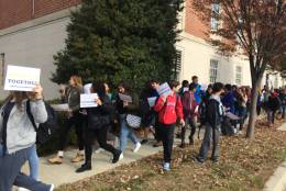 Students from Richard Montgomery High School, in Rockville, march in protest of the election of Donald Trump to the presidency Wednesday morning. A 15-year-old in a 'Make America Great Again' hat was beaten during the march. (WTOP/Nick Iannelli)
