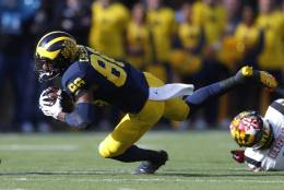 Michigan Wolverines wide receiver Jehu Chesson (86) dives for yardage against the Maryland Terrapins in the first half of an NCAA college football game in Ann Arbor, Mich., Saturday, Nov. 5, 2016. (AP Photo/Paul Sancya)
