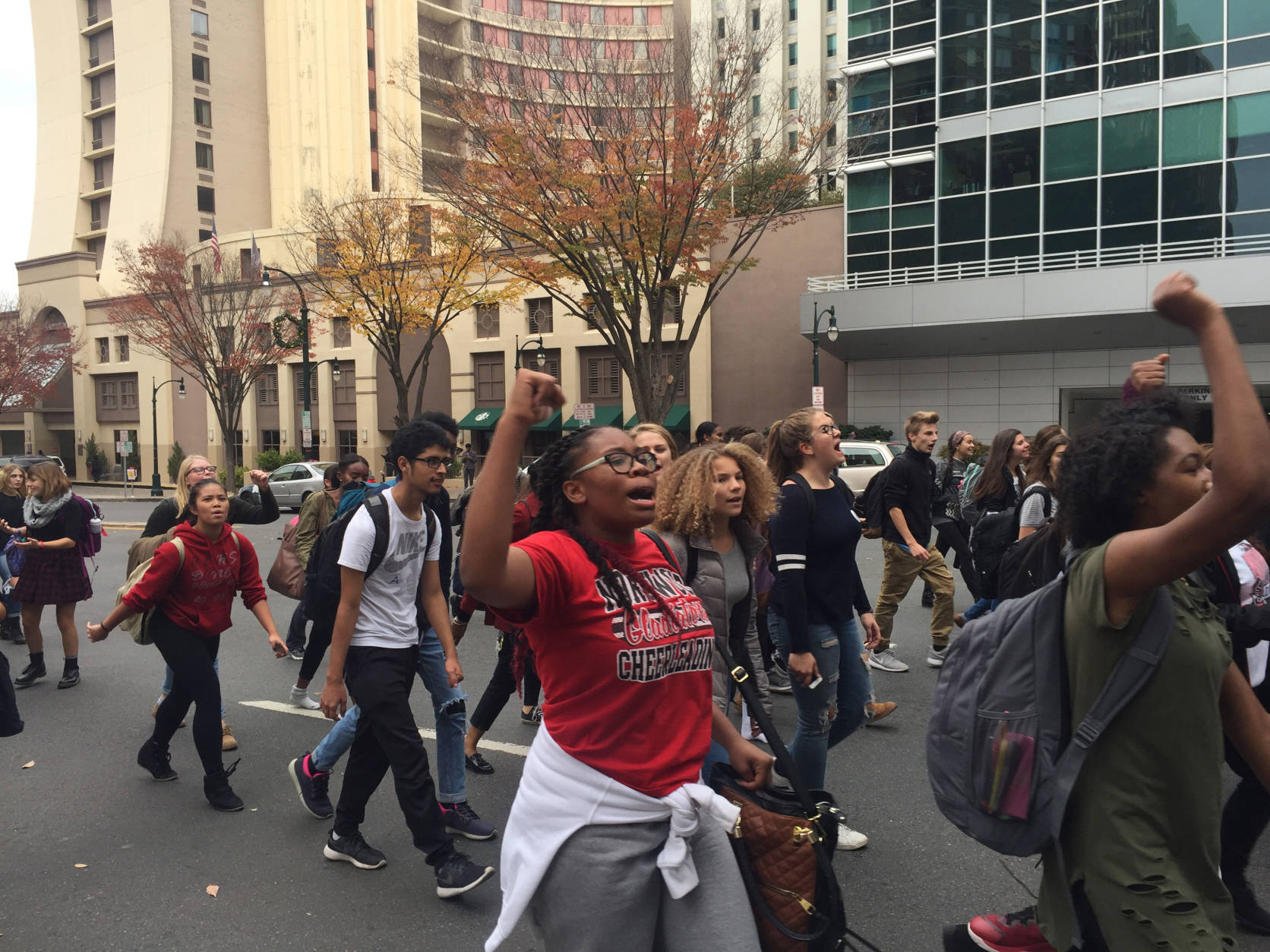 Twitter video thumbnail of high school students marching down Georgia Avenue in Silver Spring, Maryland in protest of President-elect Donald Trump on Nov. 14, 2016. (WTOP/Megan Cloherty)