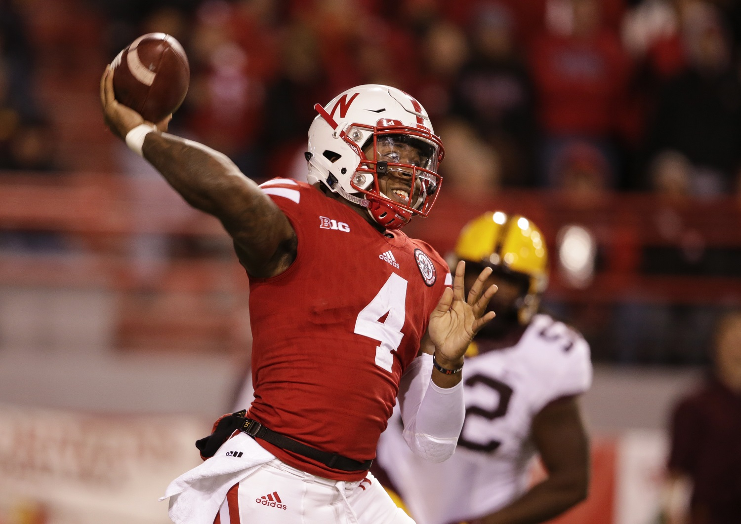 Nebraska quarterback Tommy Armstrong Jr. (4) throws in front of Minnesota defensive lineman Yoshoub Timms (52) during the second half of an NCAA college football game in Lincoln, Neb., Saturday, Nov. 12, 2016. Nebraska won 24-17. (AP Photo/Nati Harnik)