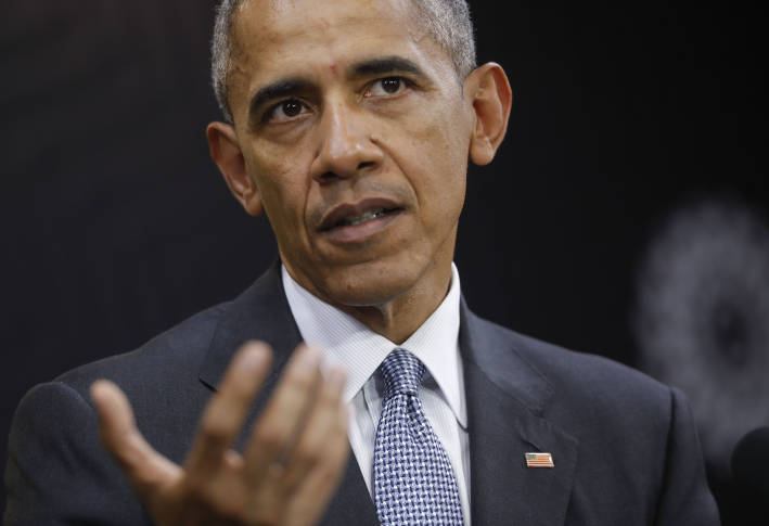 Obama warns against rush to condemn Trump trade policies