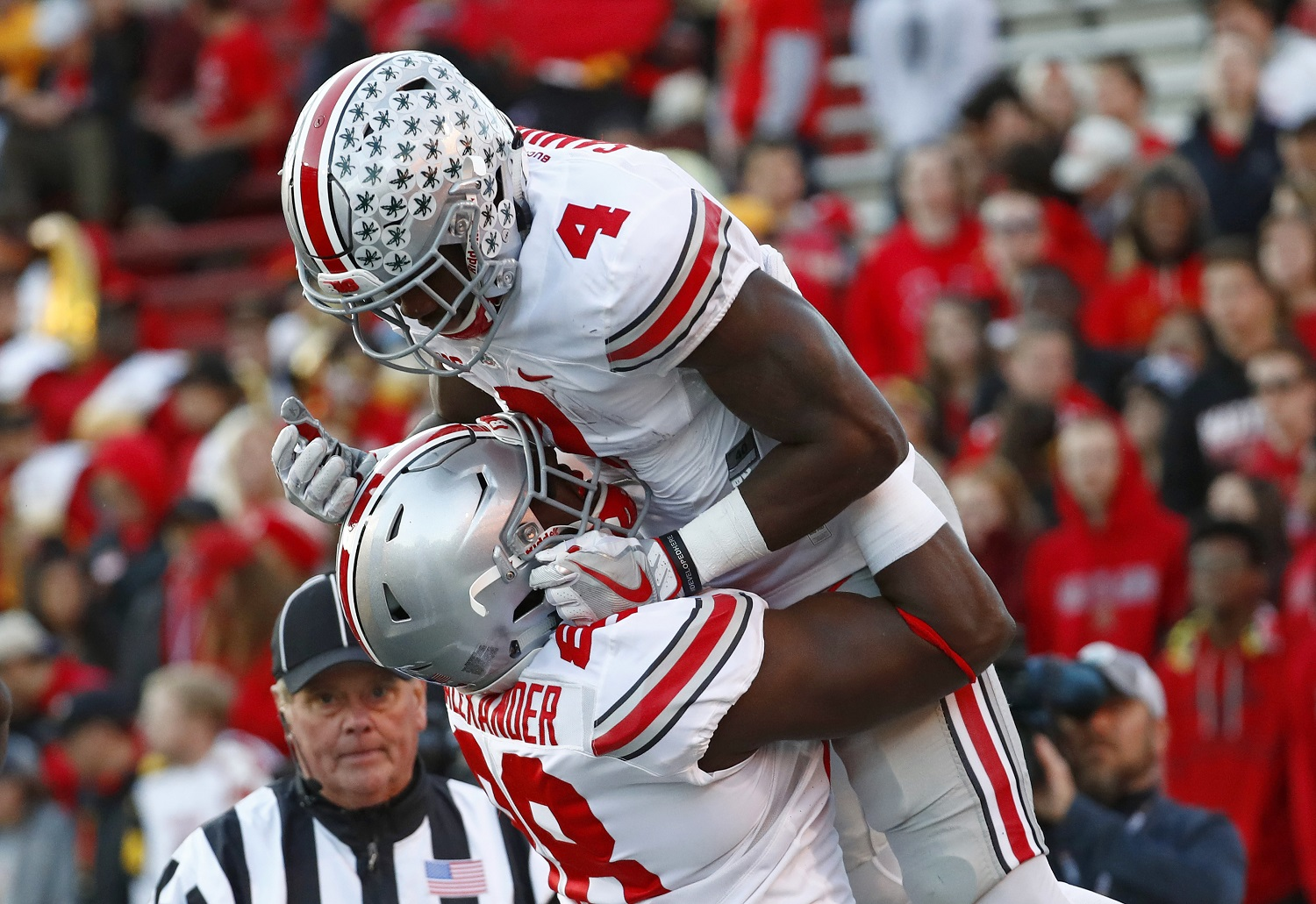 Ohio State running back Curtis Samuel, top, celebrates his touchdown with teammate A.J. Alexander in the first half of an NCAA college football game against Maryland in College Park, Md., Saturday, Nov. 12, 2016. (AP Photo/Patrick Semansky)
