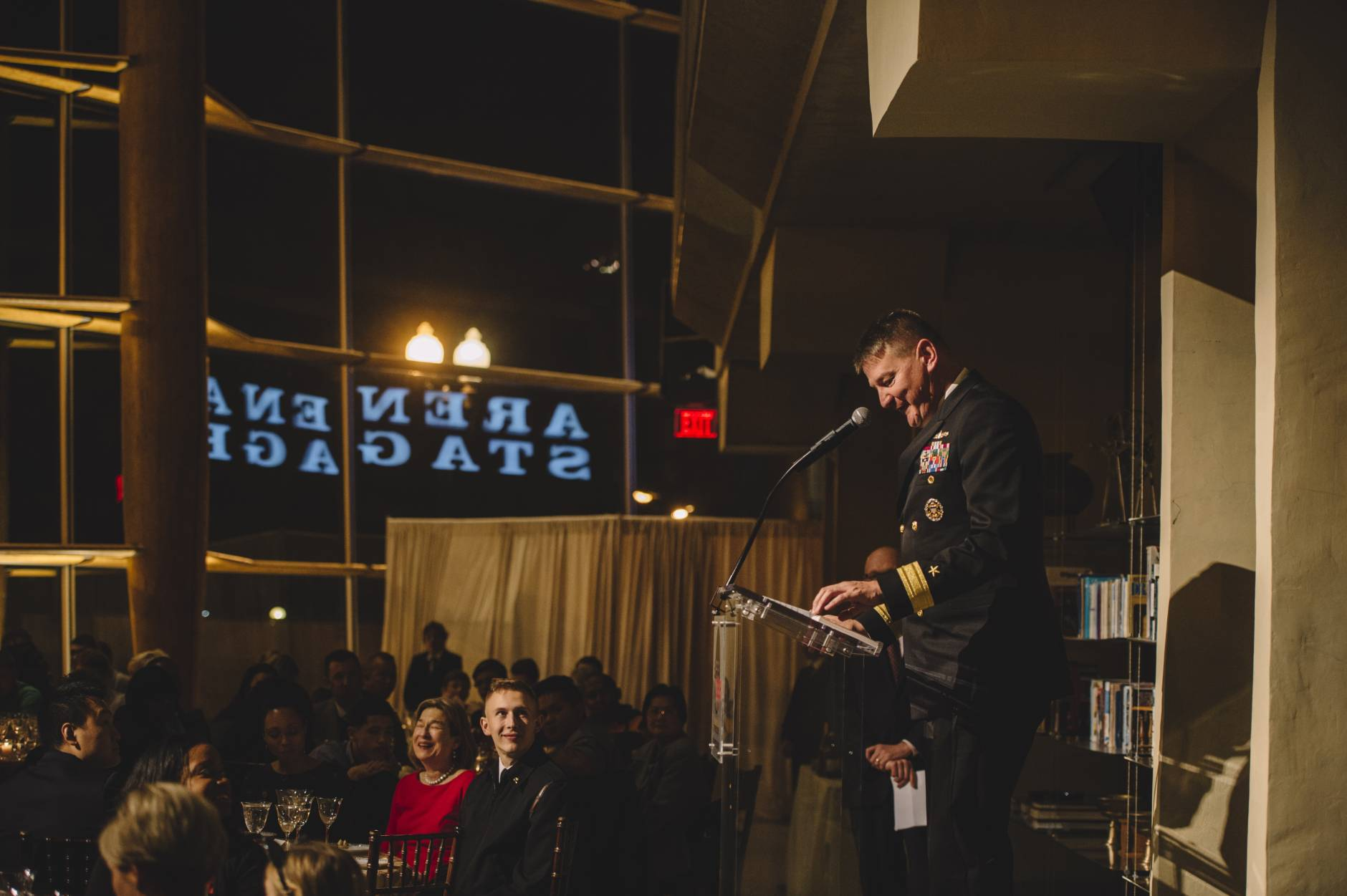In this photo, Rear Adm. Charles W. Rock addresses dinner guests. (Photo by Cameron Whitman)